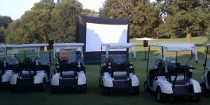 Setting up for a golf course drive-in event.