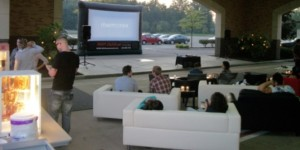 Youth group getting ready to watch a movie on our 16' x 9' screen.  They brought the indoors outside and set everything up in a living room type atmosphere.  About 150 kids showed up.  The group also provided pop, popcorn, hot pretzels and nachos to snack on during the movie.  It was a complete success.